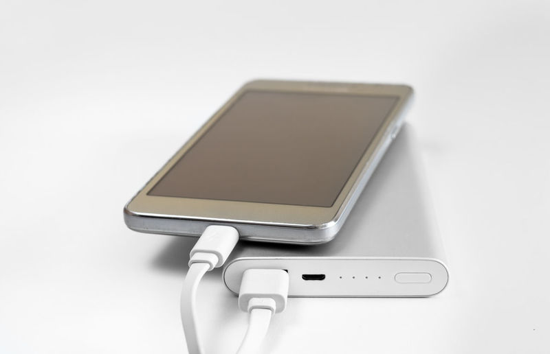 Close-up of smart phone on white background