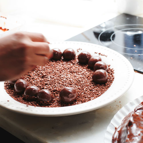 Chocolate Baked Brown Cake Close-up Dessert Finger Food Food And Drink Freshness Hand High Angle View Human Body Part Human Hand Indoors  Indulgence One Person Preparation  Preparing Food Real People Sweet Sweet Food Temptation Unrecognizable Person
