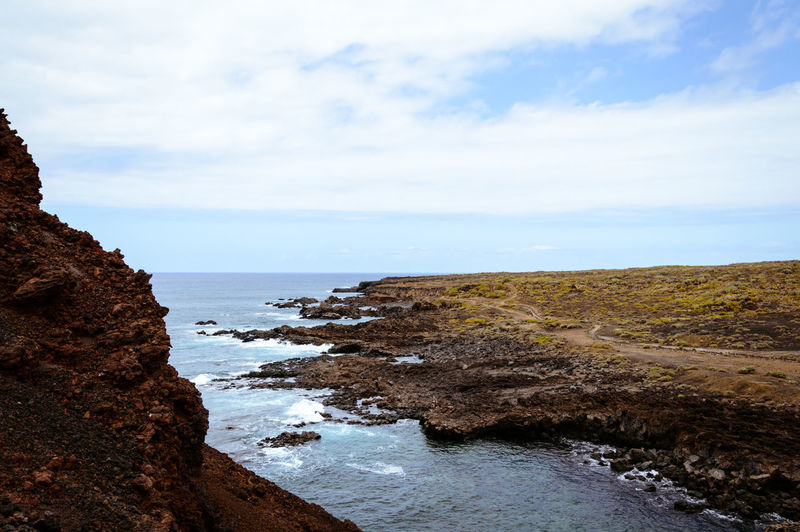 Scenic view of rocky seaside landscape under a cloudy blue sky SPAIN Beach Beauty In Nature Cloud - Sky Day First Eyeem Photo Horizon Horizon Over Water Land Landscape Nature Non-urban Scene Outdoors Rock Rock - Object Scenics Scenics - Nature Sea Sky Tenerife Tranquil Scene Tranquility Water