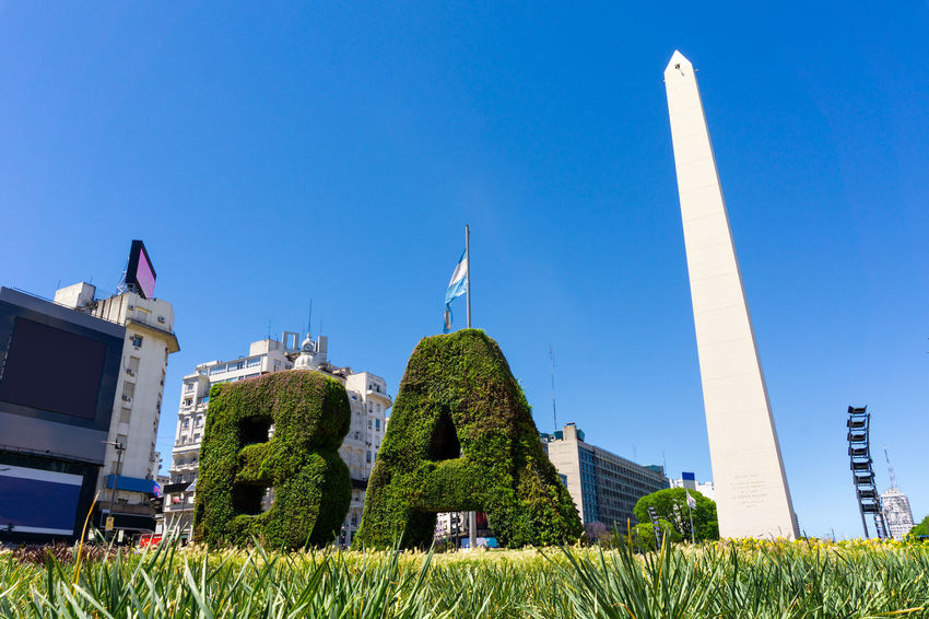 Buenos Aires Obelisk Architecture Argentina Blue Building Exterior Clear Sky Day Grass Green Color Low Angle View Nature No People Obelisco Obelisco, Buenos Aires 🌆 Outdoors Sky Tree