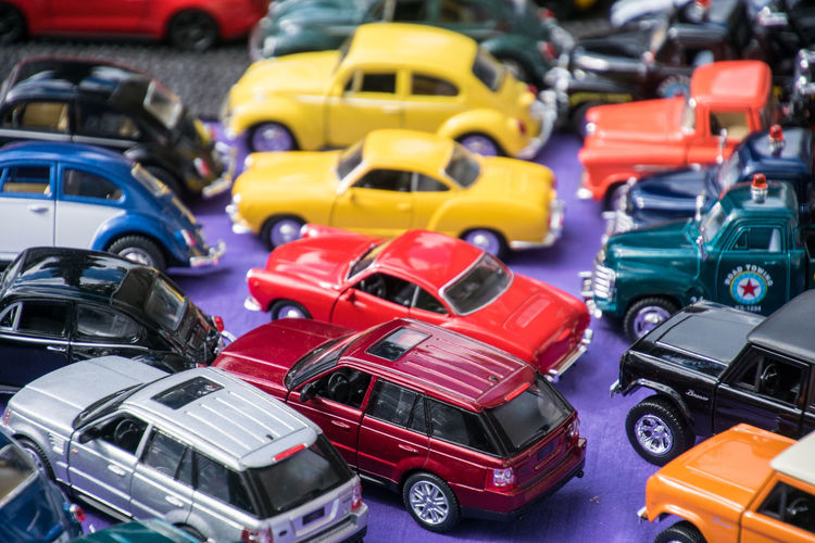 High Angle View Of Colorful Toy Cars For Sale In Store