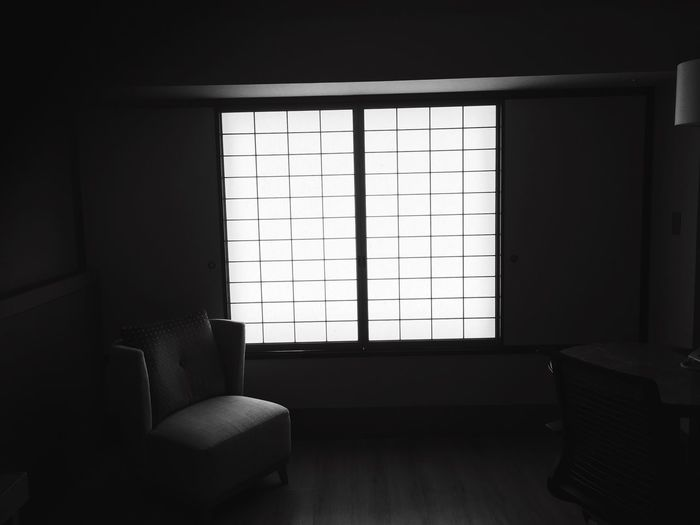 Empty Armchair In Room Against Window