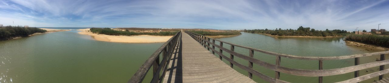 Panoramic Water Sky Tranquil Scene The Way Forward Footbridge Connection Tranquility Scenics Long Railing Sea River Calm Narrow Cloud Day Diminishing Perspective Beauty In Nature Pedestrian Walkway Portugal Algarve River View beach Golf hotel Tide Nature