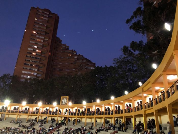 Torres Del Parque Large Group Of People Night Illuminated Men Crowd Real People Architecture Building Exterior Tree Sky