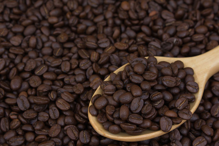 Coffee beans in wood ladle Abundance Brown Cappuccino Close-up Coffee - Drink Coffee Bean Coffee Cup Day Food Food And Drink Freshness Group Of Objects Indoors  Large Group Of Objects Mocha No People Raw Coffee Bean Roasted Roasted Coffee Bean Scented