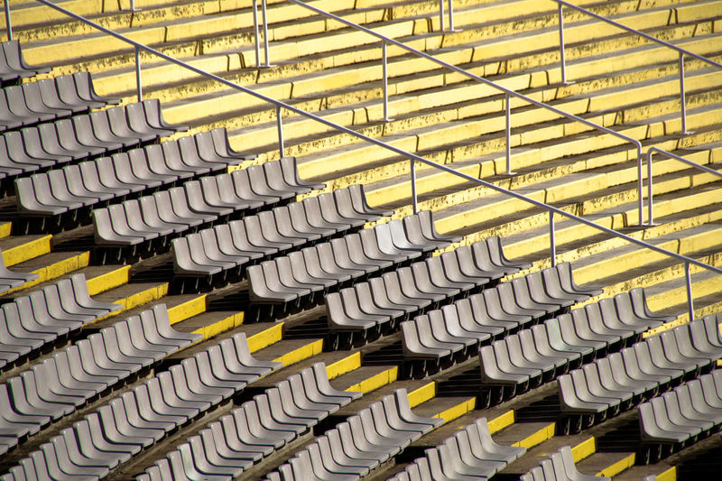 High angle view of empty chairs in stadium