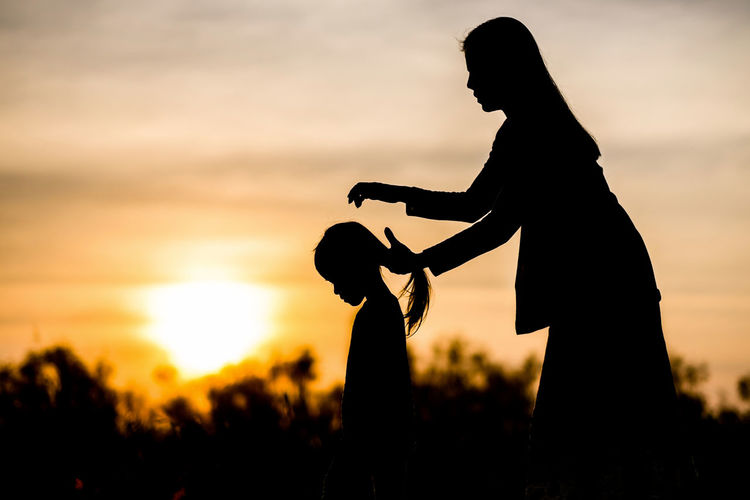 Adult Care Family Females Field Hair Ties Human Body Part Human Hand Mother And Daughter Nature Outdoors People Silhouette Silhouette Single Mom  Single Mother Sky Sport Summer Sunset Two People Warm Colors Women Young Adult