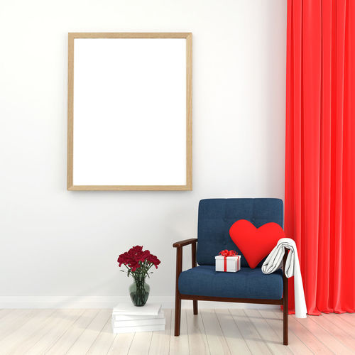 Empty chair against blue wall at home