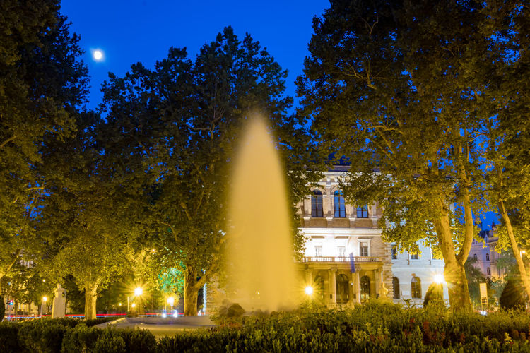 City Life Fountain Night Lights Night Photography Nightphotography Zagreb Zagreb, Croatia Architecture Building Exterior Built Structure City History Illuminated Lighting Equipment Long Exposure Nature Night No People Outdoors Park Plant Sky Travel Travel Destinations Tree