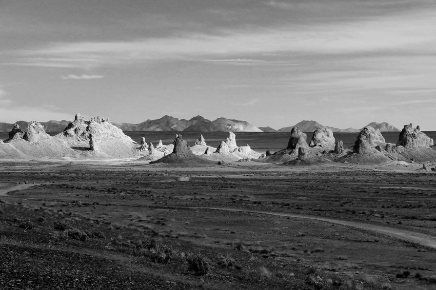 Underwater formations in dried up lake Desert Pinnacles Rock Formations Arid Climate Beauty In Nature Black And White Photography Day Desert Dried Up Lake Geology Landscape Mountains Nature No People Non-urban Scene Outdoors Physical Geography Scenics Sky Sunlight And Shadow Tranquil Scene Tranquility Trona Pinnacles