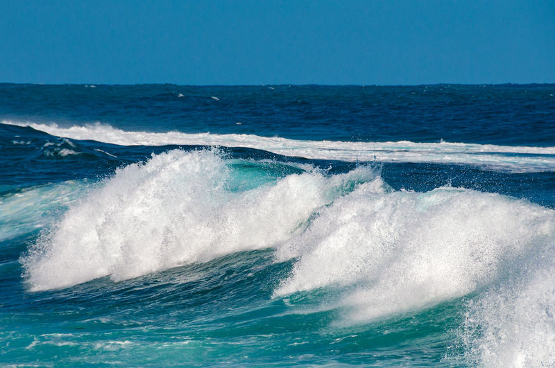 Seascape with massive wave with white foam nature background, texture