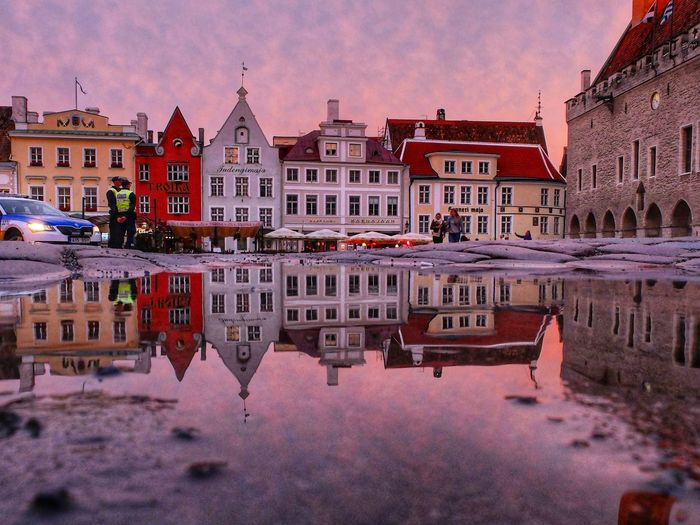 Architecture Building Exterior Water Travel Destinations Reflection Outdoors Sky Cityscape Built Structure Nautical Vessel No People City Day Sunset Architecture Walking Around Travel Tourism Puddle Market Square Cobblestone Town Hall Town Hall Square Purple Police