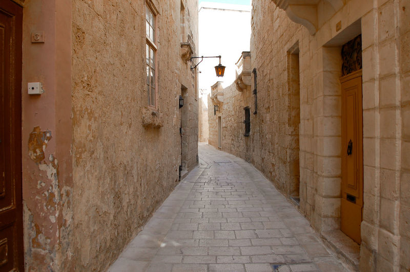 Narrow street amidst buildings
