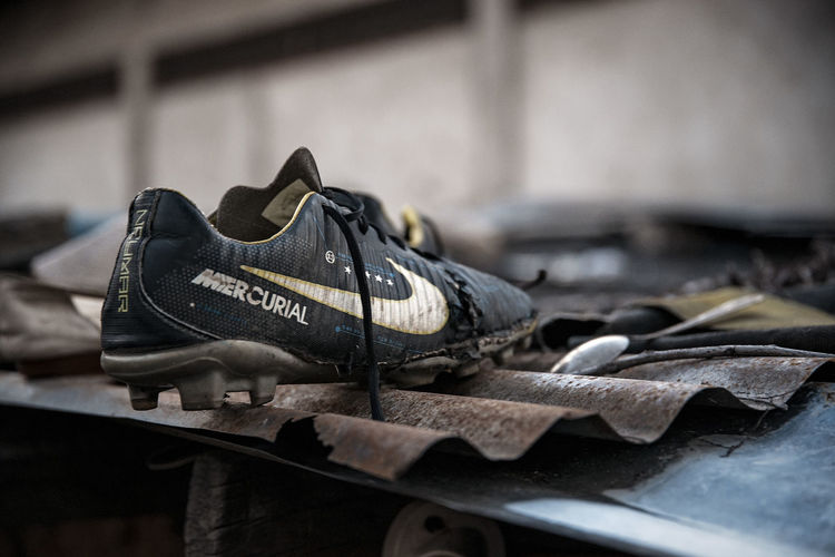 Soccer Shoes Mercurial Rooftop Shoe No People Pair Indoors  Selective Focus Still Life Old Focus On Foreground Abandoned Close-up Work Tool Shoemaker Workshop Table Boot Man Made Object Craft Man Made Day Leather Personal Accessory