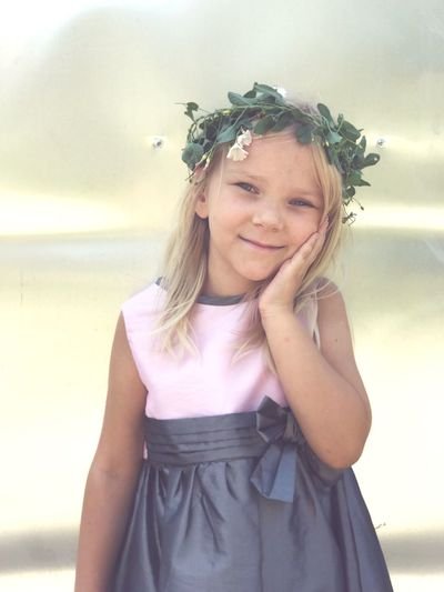 Portrait of smiling girl wearing tiara while standing outdoors