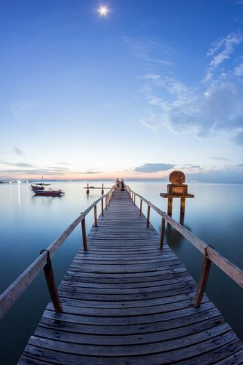 View of wooden bridge and sunrise in Penang Island, Malaysia Jetty Landscape Penang Penang Island Penang Malaysia Ray Sea Sea And Sky Sea View Seascape Seaside Sunset Sunset_collection Village Wooden Wooden Bridge Wooden Post