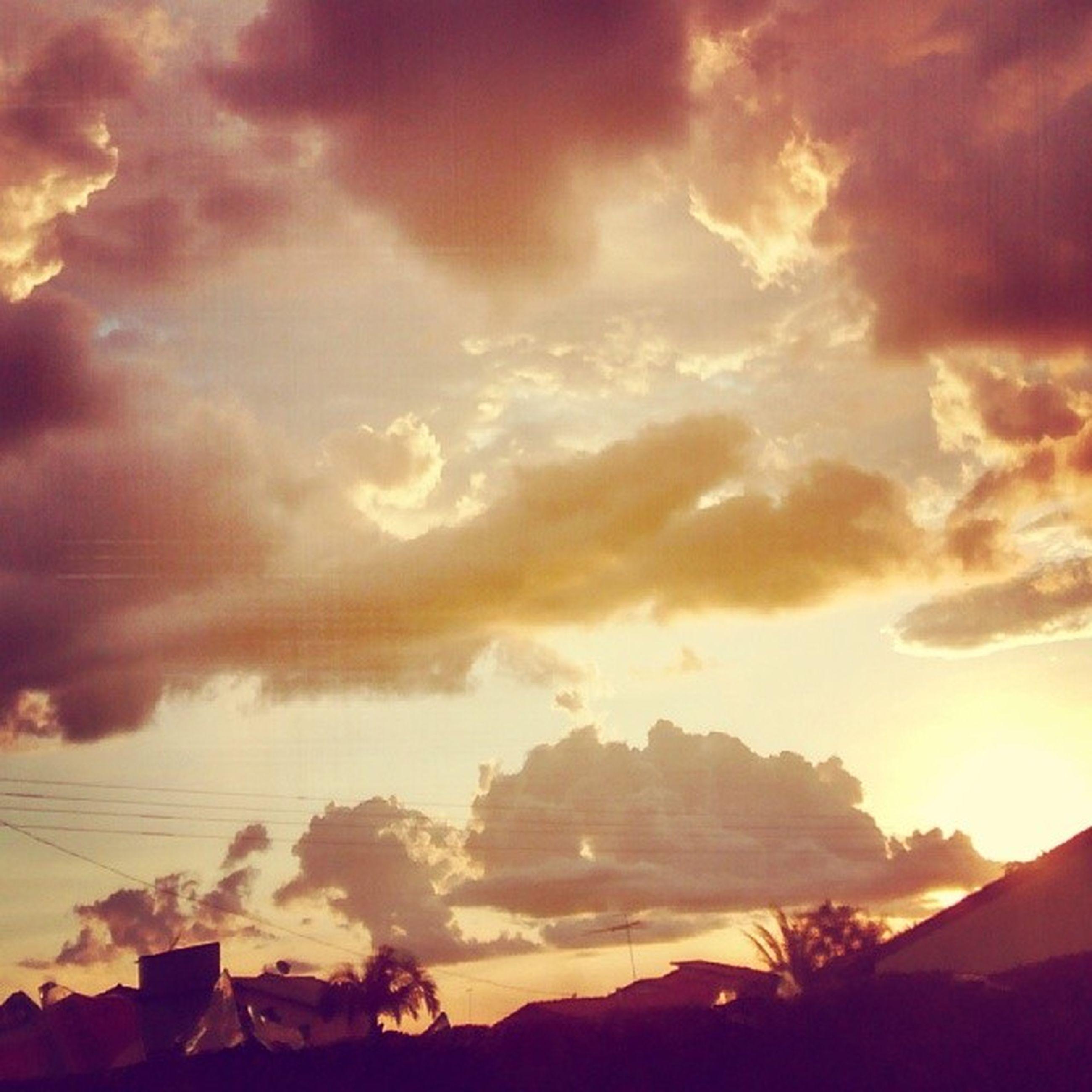 sky, sunset, cloud - sky, scenics, tranquil scene, beauty in nature, tranquility, silhouette, nature, sun, cloudy, sunbeam, mountain, idyllic, cloud, landscape, tree, sunlight, dramatic sky, orange color