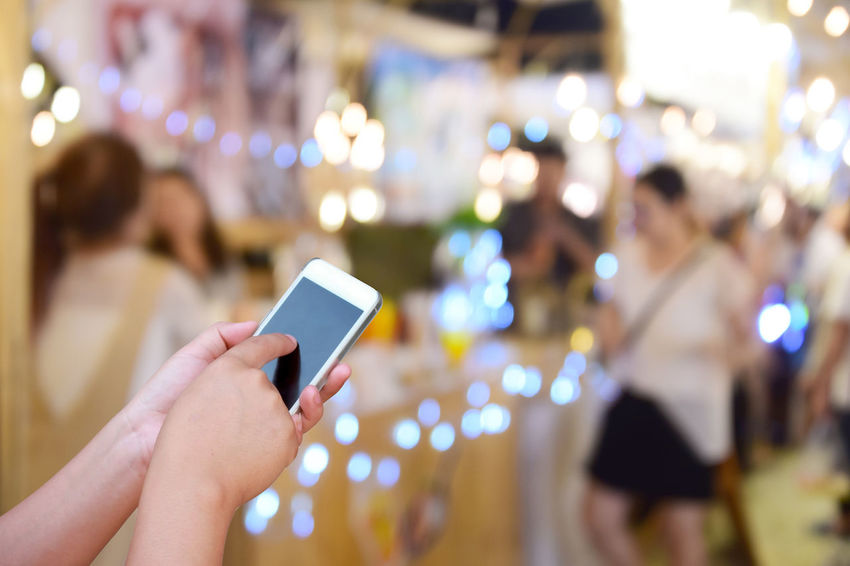 blurred image hand hold and touch screen smart phone and food at night festival with bokeh background Business Celebration Circle City Cityscape Colors Dark Event Fashion Backgrounds Blue Blur Bokeh Building Ciub Clown Decoration Defocused Dowtown Evening Festival Festive Food Glow Group