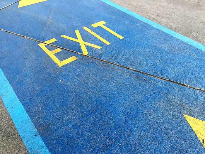 High angle view of exit sign on street