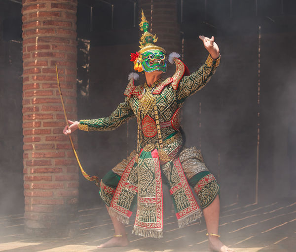 Full Length Of Man Wearing Traditional Clothing While Dancing