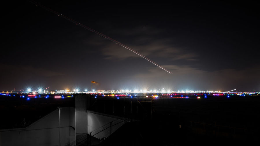 Airplane against sky at night