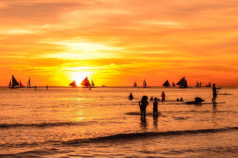 Beautiful Sunsets in Boracay Sunset Sky Orange Color Water Sea Group Of People Real People Beach Beauty In Nature Silhouette Lifestyles Scenics - Nature Nature Land Cloud - Sky People Leisure Activity Nautical Vessel Men Outdoors