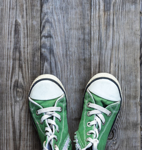 Close-up of canvas shoes on hardwood floor