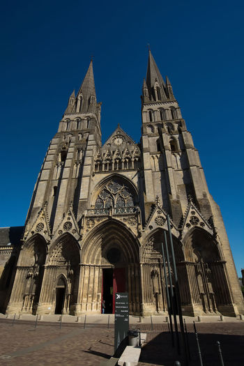 Cathédrale Notre-Dame de Bayeux Arch Architecture Bayeux Blue Built Structure Capital Cities  Cathedral Church Day Exterior Façade Famous Place France History Low Angle View No People Ornate Outdoors Place Of Worship Religion Sky Spirituality Tourism Travel Destinations