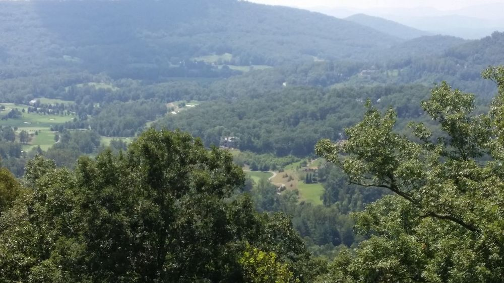 Ashville North Carolina Chimney Rocks, NC Cruising Through Hilly Zigzag Road HARSHEEL SHAH Nature Mountain Top No Pollution Seas Of Tree Covered Mountains Trees And Nature