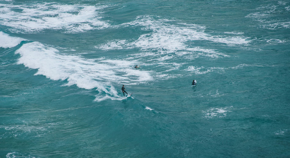 High angle view of man surfing on sea