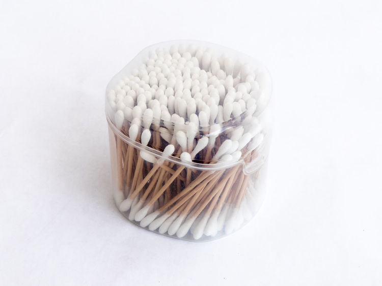 Almost full plastic transparent packing with cotton swabs for cleaning the ears isolated on a white background Box Business Container Hygiene Isolated Lifestyle Medicine Shape Soft Bathroom Clean Clear Close-up Cotton Design Ear Health Pack Package Plastic Protection Studio Shot Swab Transparent White Background