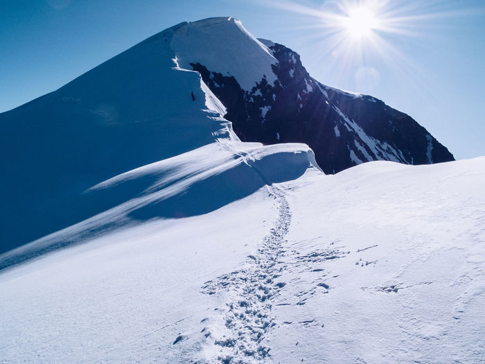 Adventure Alpine Alps Altitude Challenge Climbing Cold Cold Temperature Extreme Sports Freezing Frozen High Ice Mountain Mountain Climbing Mountaineering Nature No People Rock Snow Summit Sun Sunlight Tracks Wind
