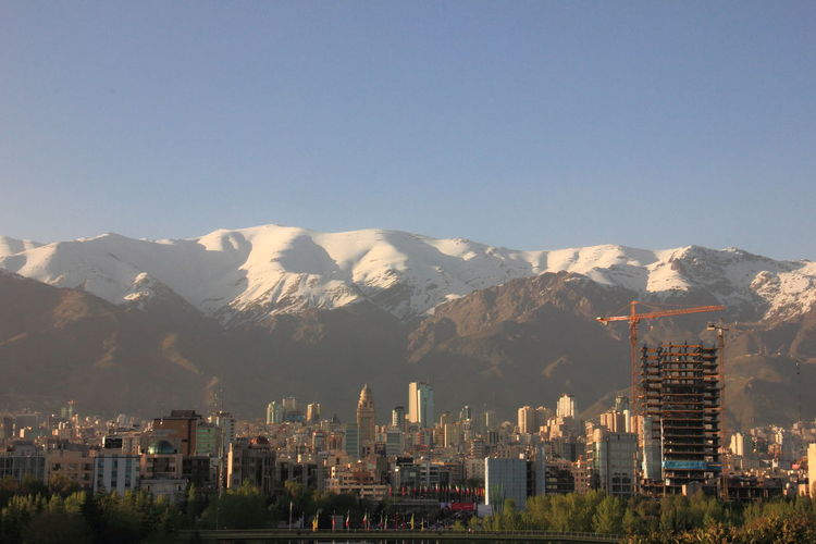 View of buildings against mountain range