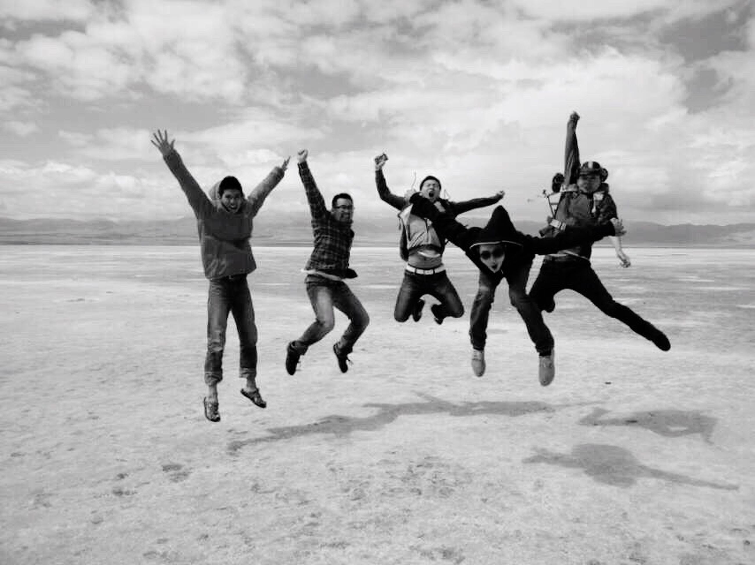 beach, lifestyles, leisure activity, full length, sky, sand, sea, animal themes, togetherness, men, shore, standing, person, cloud - sky, water, vacations, enjoyment