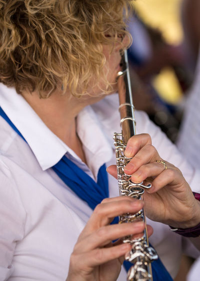 Close-up of woman playing musical instrument