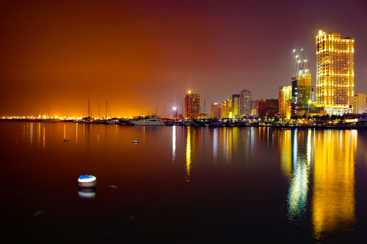 CITY LIGTHS City Cityscape Urban Skyline Water Illuminated Skyscraper Sunset Neon Nightlife Modern Office Building Waterfront Countryside Dramatic Sky Calm Boat Tower Atmospheric Mood