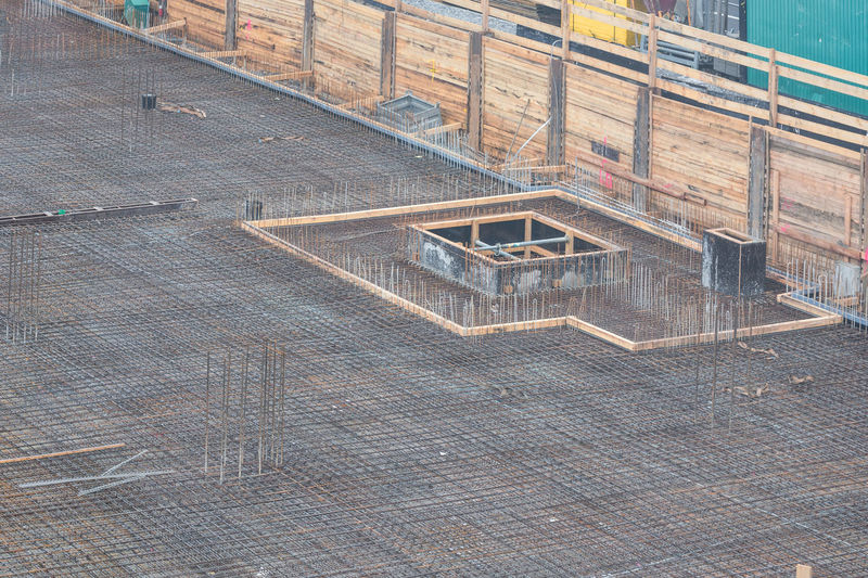 Foundation building of steel and concrete for the construction of an apartment building with underground parking. Architecture Base Plate Smart Built Structure Day Foundation No People Outdoors Reinforcing Steel Bars