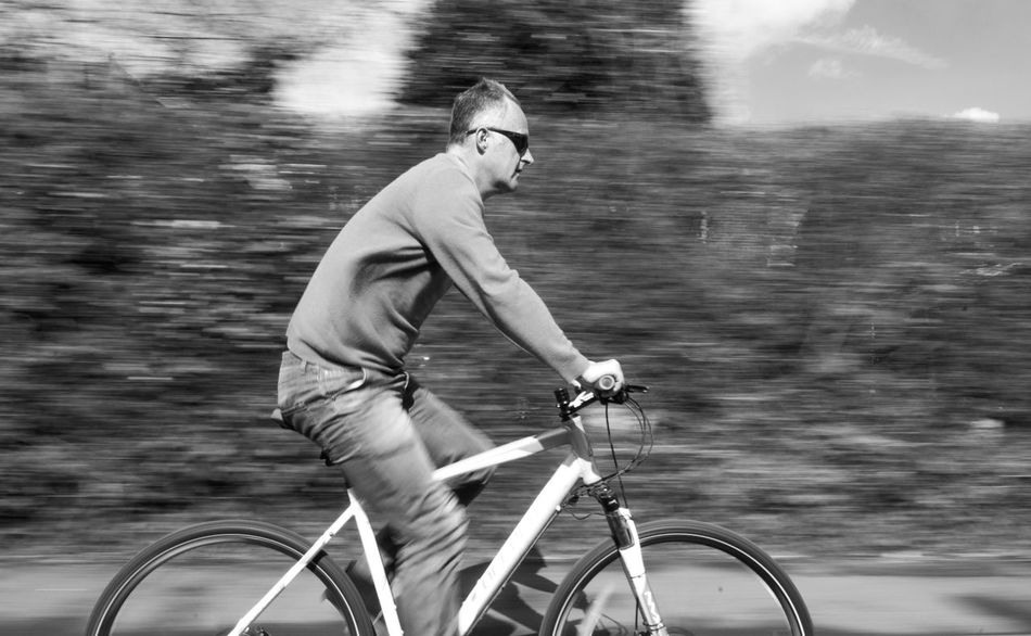 Bicycle Bike Casual Clothing Cycle Cycling Around Cyclist Day Fast Fit Fitness Focus On Foreground Leisure Activity Lifestyles Man Mode Of Transport Motion Motion Blur Movement Photography Nature Outdoors Sky Speed Sport