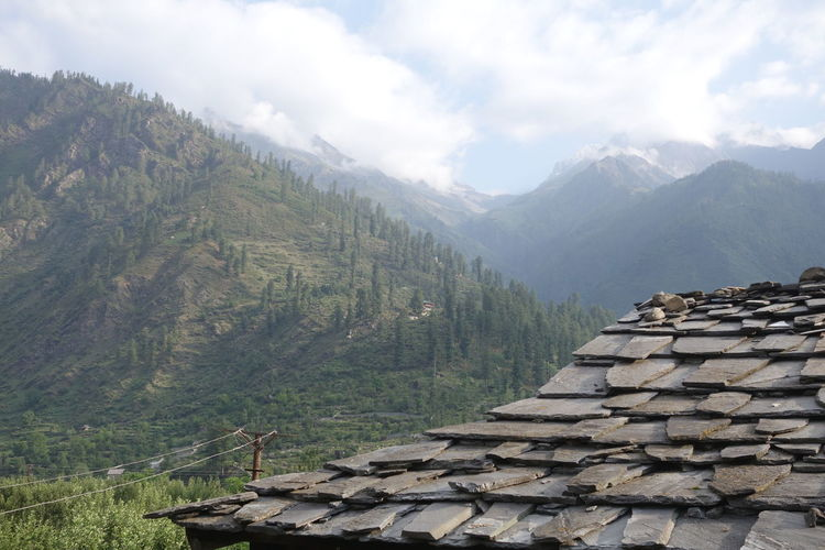 Architecture Beauty In Nature Cloud - Sky Environment Forest Landscape Mountain Mountain Peak Mountain Range Nature Outdoors Roof Tile Scenics - Nature Sky Stone Wall Tranquil Scene Tree