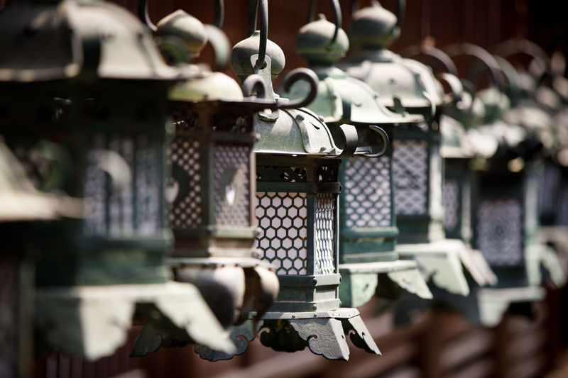 Japan lanterns Japan Lantern Lantern Japan Nara Temple Temple Architecture Lamps Metal No People Selective Focus Hanging Technology Close-up Day Focus On Foreground In A Row Architecture Bell Outdoors Old Protection Connection History Pattern Security Human Representation