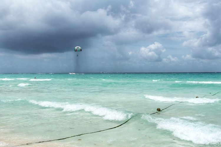 Sea Beach Horizon Over Water Water Sand Cloud - Sky Nature Vacations Scenics Wave Beauty In Nature Tropical Climate Sky Travel Destinations Outdoors Adult Day Standing Full Length Nautical Vessel Mexico Leisure Activity Sport Beach Storm Storm Cloud
