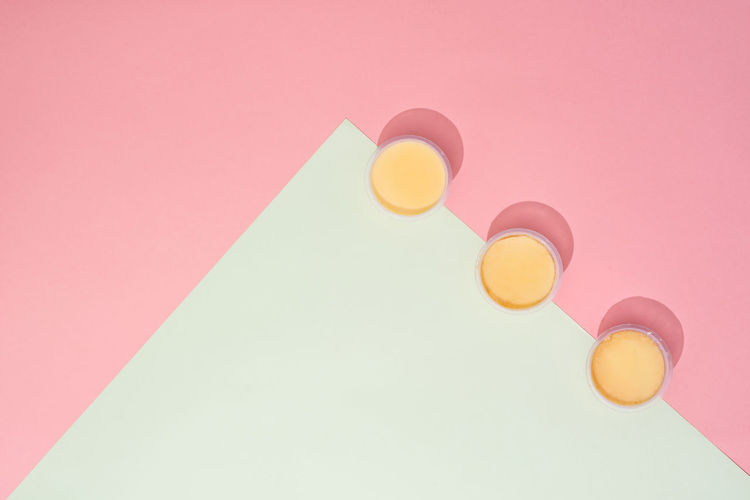 High angle view of multi colored lights on pink background