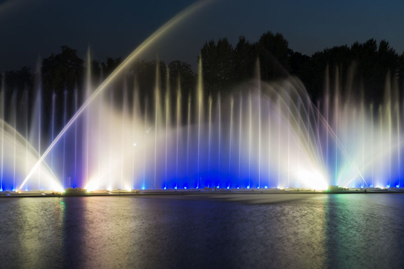 Panoramic view of fountain against sky at night