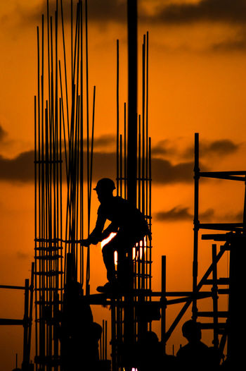 Silhouette Of Construction Worker At Sunset
