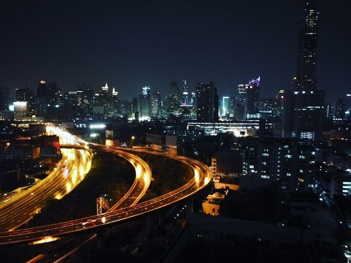High angle view of light trails on elevated road in city at night