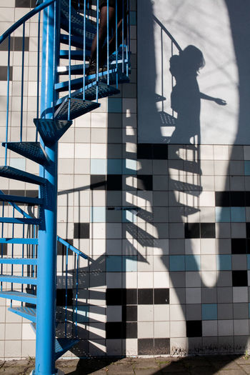 Shadow of man on staircase of building