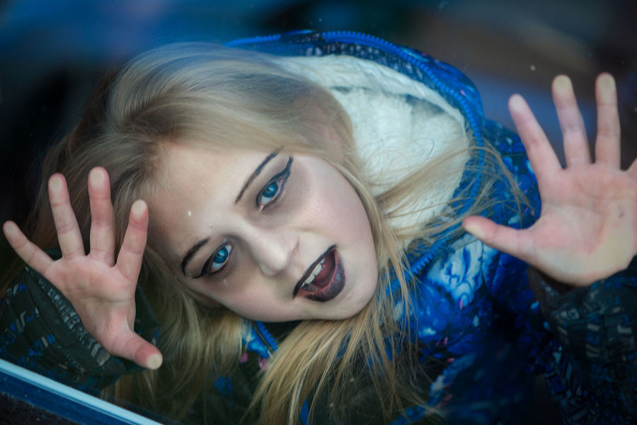Halloween girl behind the window Blue Tones Blue Eyes Halloween Halloween Girl Makeup Portraits Adult Adults Only Beauty Behind Window Blond Hair Close-up Girl Happiness Headshot Human Hand Looking At Camera Make Up Night One Person Outdoors People Portrait Smiling Young Adult
