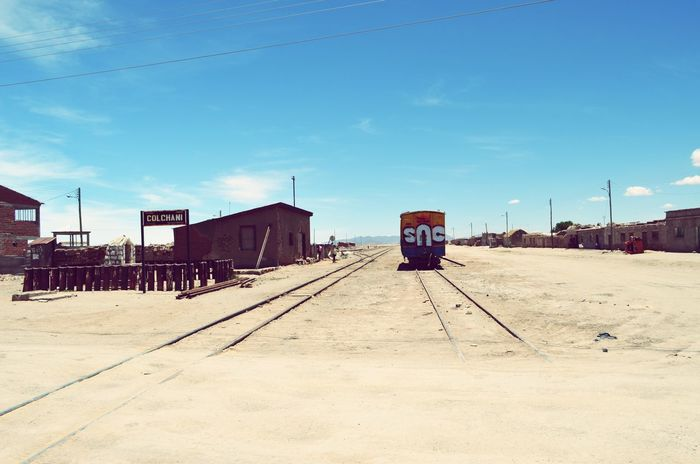 Town in Bolivia Building Exterior Sky Transportation Sunlight Railroad Track Built Structure Outdoors Day Public Transportation Architecture Text No People Nature Bolivia Bolivia Uyuni