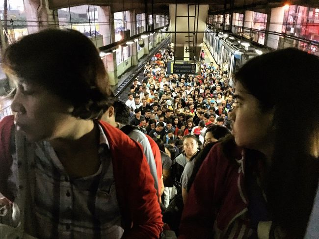 Train rush hour in Metro Manila. Due to limited trains in the city this flock of people in the train station is a usual site. Streetphotography City Life The Photojournalist - 2017 EyeEm Awards