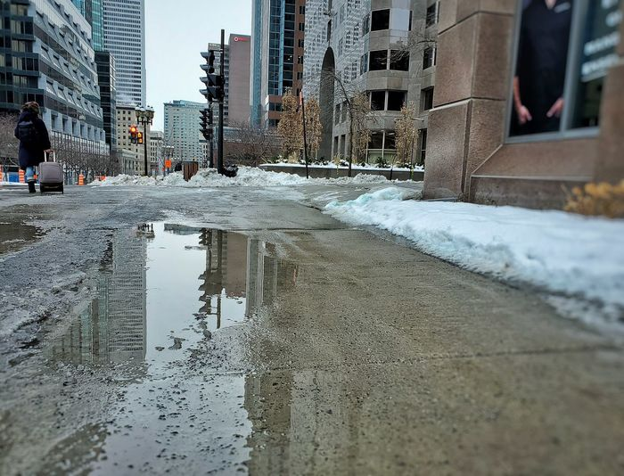 Surface level of wet road in city during winter